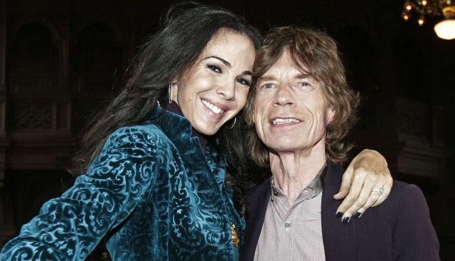 Mick Jagger poses for photos with L'Wren Scott in New York on Feb. 16, 2012. Photo: AP Photo