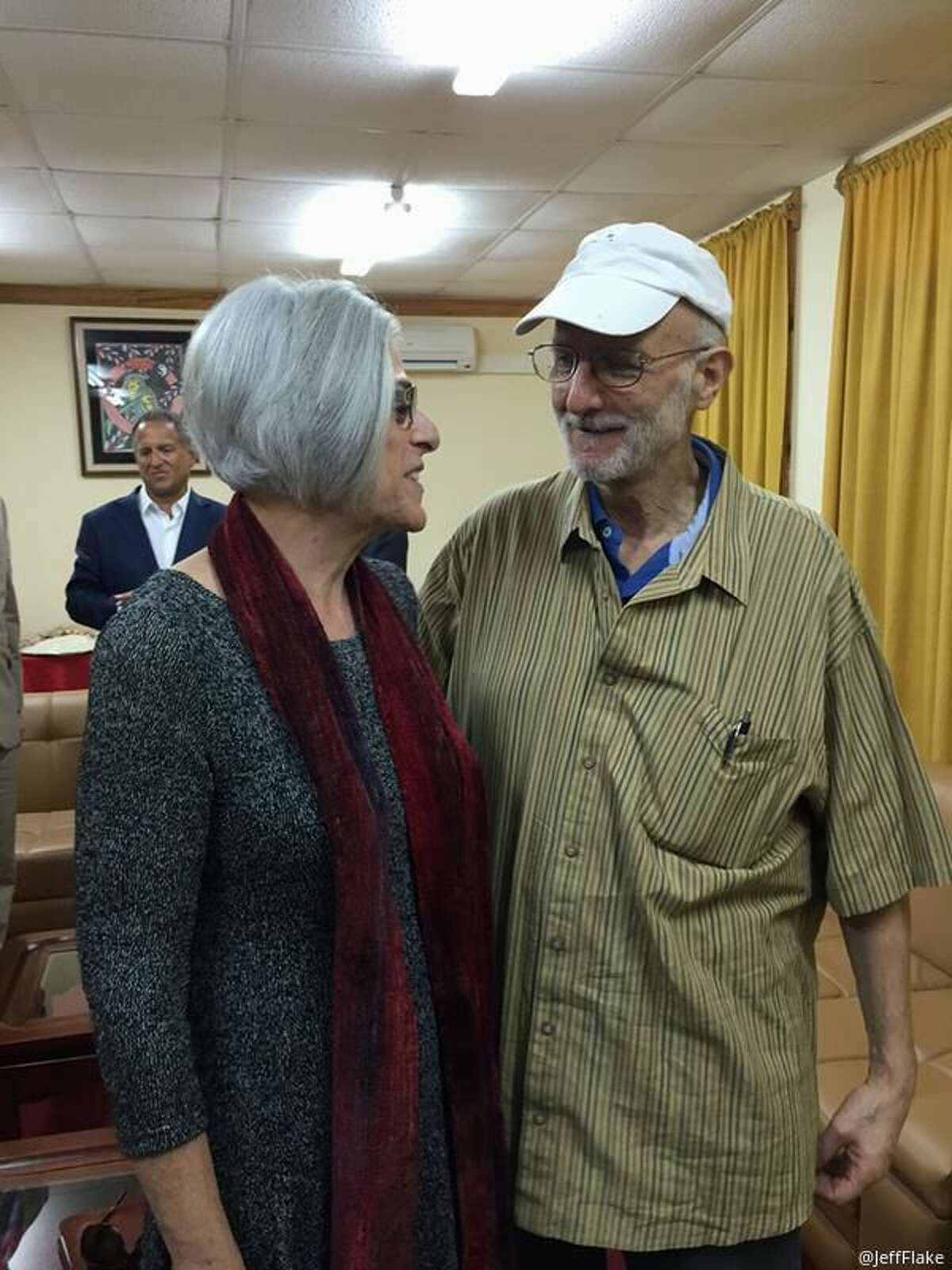 This handout photo from the Twitter account of Sen. Jeff Flake, R-Ariz. shows Alan Gross with his wife Judy before leaving Cuba, Wednesday, Dec. 17, 2014. The US and Cuba have agreed to re-establish diplomatic relations and open economic and travel ties, marking a historic shift in U.S. policy toward the communist island after a half-century of enmity dating back to the Cold War, American officials said Wednesday. The announcement came amid a series of sudden confidence-building measures between the longtime foes, including the release of American prisoner Alan Gross, as well as a swap for a U.S. intelligence asset held in Cuba and the freeing of three Cubans jailed in the U.S. (AP Photo/Jeff Flake)