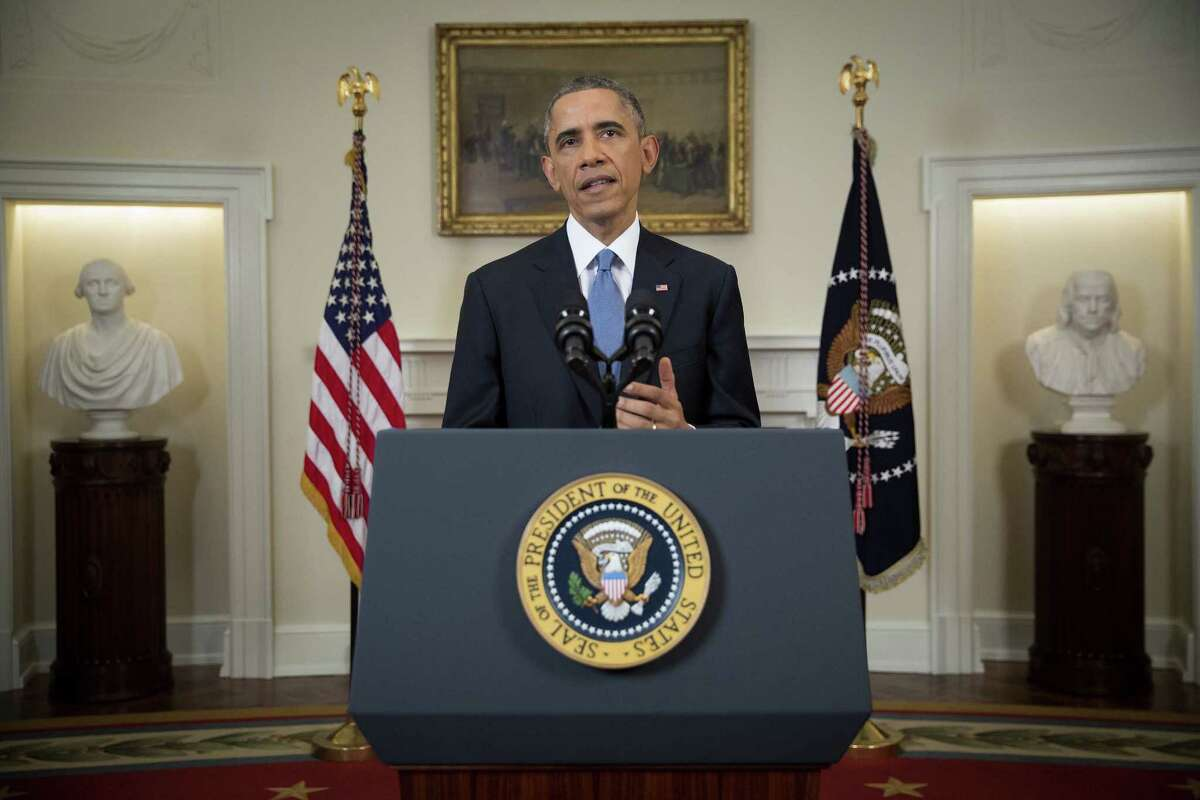 President Barack speaks in the Cabinet Room of the White House in Washington, Wednesday, Dec. 17, 2014, to announce the U.S. will end its outdated approach to Cuba that has failed to advance U.S. interests. (AP Photo/Doug Mills, Pool)