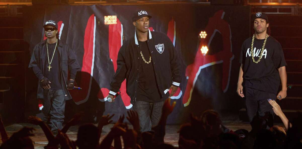 """This photo provided by Universal Pictures shows, Jason Mitchell, from left, as Eazy-E, Corey Hawkins as Dr. Dre, and O'Shea Jackson, Jr. as Ice Cube in the film, """"Straight Outta Compton."""""""