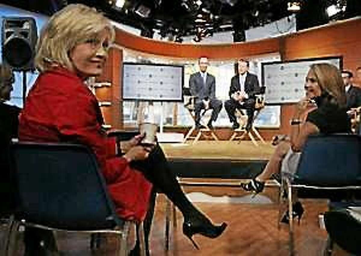 ABC News' Diane Sawyer, left, and Katie Couric, flank ABC News President Ben Sherwood, background left, and Ross Levinsohn, background right, Yahoo's Executive Vice President of Americas, during a news conference in New York, Monday, Oct. 3, 2011.