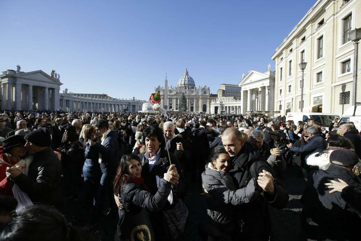 People dance tango in front of St. Peter's Square to celebrate Pope Francis 78th birthday, at the Vatican, Wednesday, Dec. 17, 2014. Hundreds of tango dancers from all over the world gathered just next to St. Peter's Square for a milonga to mark Pope Francis' 78th birthday. (AP Photo/Gregorio Borgia)