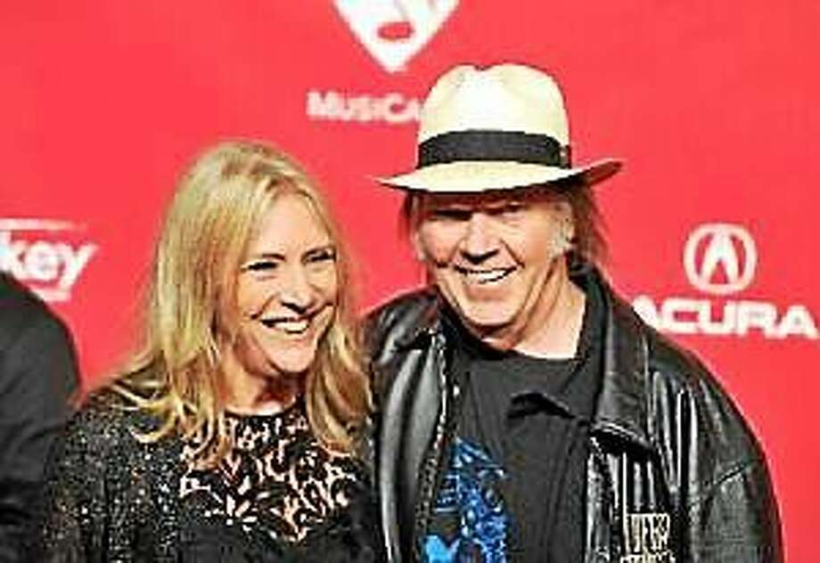 Neil Young and Pegi Young arrive at the 2012 MusiCares Person of the Year Tribute to Paul McCartney, held at the Los Angeles Convention Center on February 10, 2012 in Los Angeles. Photo: (Kevin Winter — Getty Images)