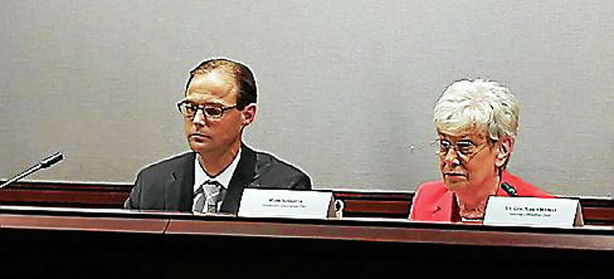 Mark Schaefer, director of Health Innovation, and Lt. Gov. Nancy Wyman listen to testimony during the July 10 meeting in Hartford.