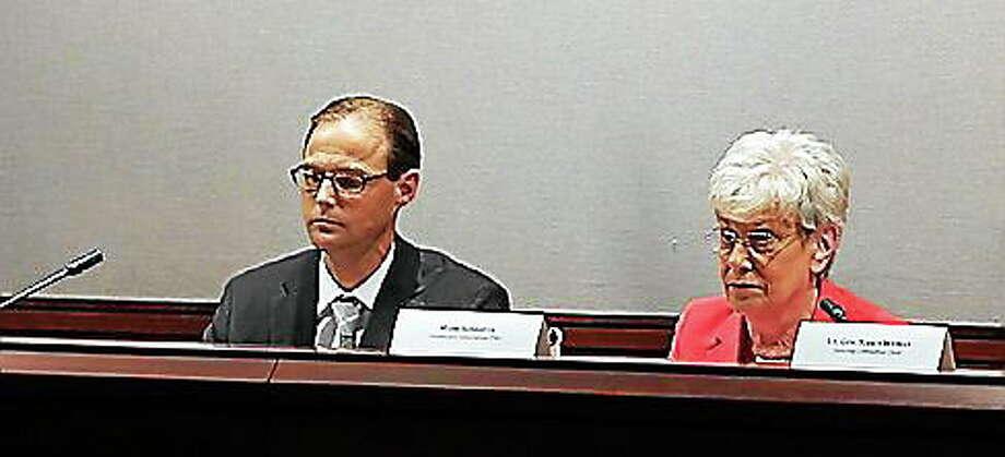 Mark Schaefer, director of Health Innovation, and Lt. Gov. Nancy Wyman listen to testimony during the July 10 meeting in Hartford. Photo: Christine Stuart — CTNewsJunkie