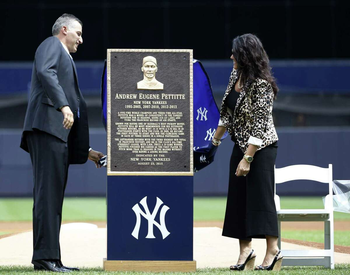 Andy Pettitte, left, and his wife Laura unveil Pettitte's Monument Park plaque during a pregame ceremony on Sunday.