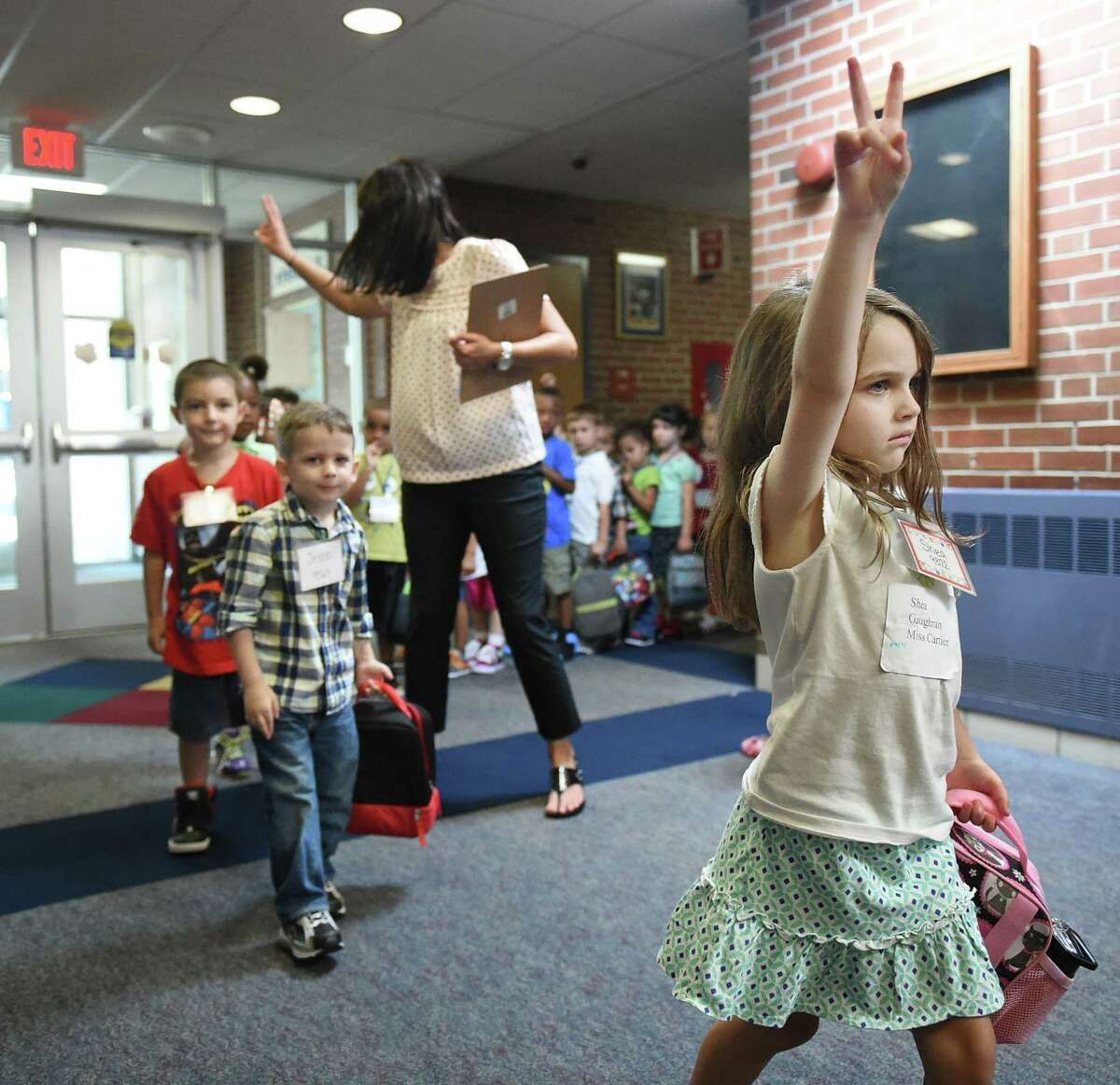 Catherine Avalone - The Middletown Press Shea Gaughran, a student in Miss Cartier's kindergarten class has learned the ropes early in the first day of school at Edna C. Stevens Elementary School in Cromwell Wednesday.