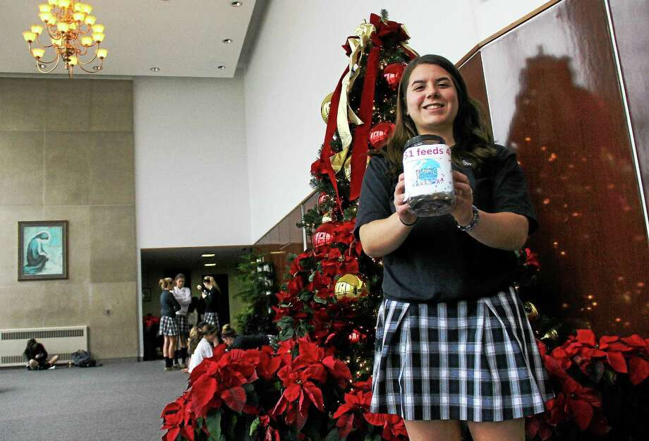 Mercy High School senior Jacqueline Kasinskas launched a fundrasier to cover costs of 12,000 meals for hungry people in the area. Photo: Kathleen Schassler — The Middletown Press  / Kathleen Schassler All Rights
