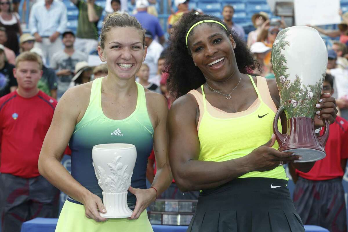 Serena Williams, right, holds the Rookwood Cup after defeating Simona Halep in the women's final at the Western & Southern Open on Sunday.