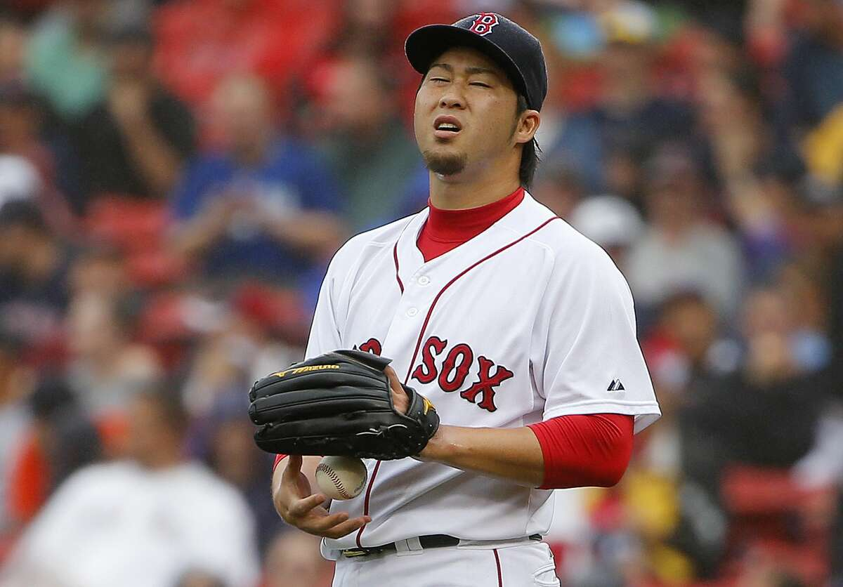 Red Sox relief pitcher Junichi Tazawa reacts during the ninth inning on Sunday.
