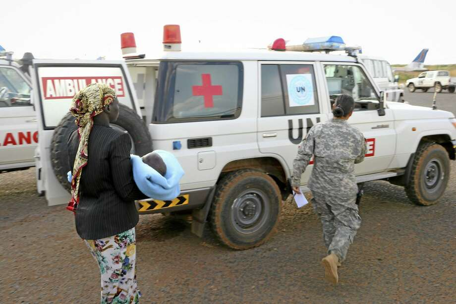In this December 2013 photo, wounded civilians from Bor, the capital of Jonglei state and said to be the scene of fierce clashes between government troops and rebels, are assisted after being transported by U.N. helicopter to Juba, South Sudan. Photo: File Photo  / UNMISS