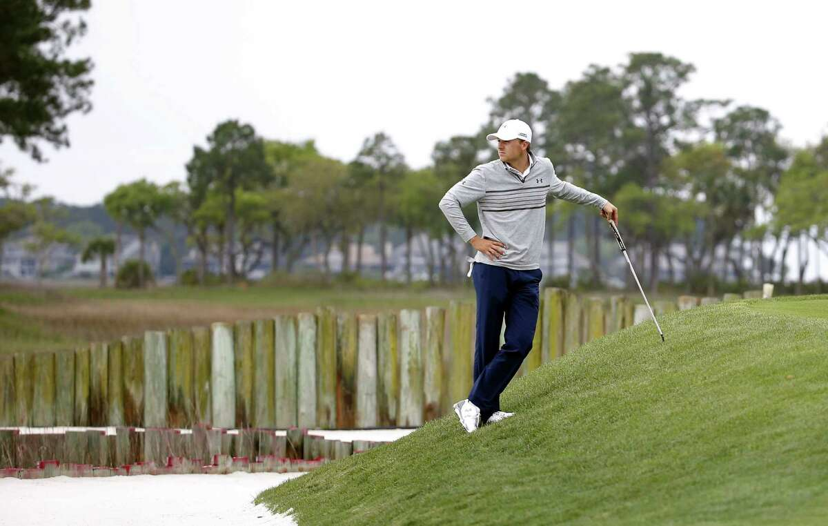Jordan Spieth waits for his turn to putt on the 17th green during the second round of the RBC Heritage Friday in Hilton Head Island, S.C.