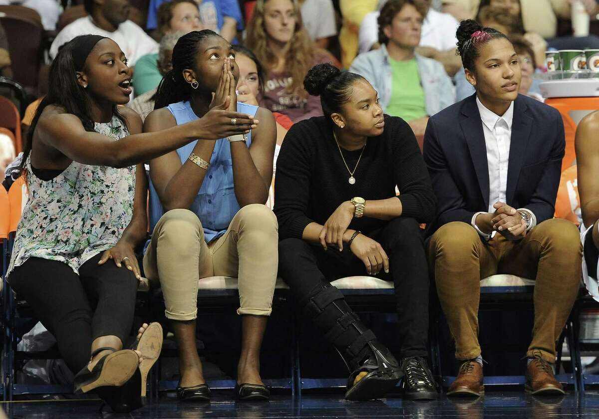 From left, the Connecticut Sun's Chiney Ogwumike, Elizabeth Williams, Alex Bentley and Alyssa Thomas watch a foul called against their team during the first half Sunday.