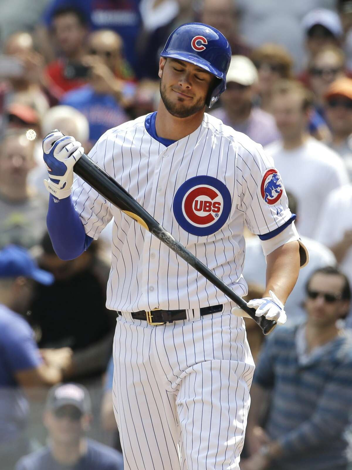 Cubs rookie Kris Bryant reacts after striking out in his first major league at-bat in the first inning of Friday's game against the San Diego Padres in Chicago.