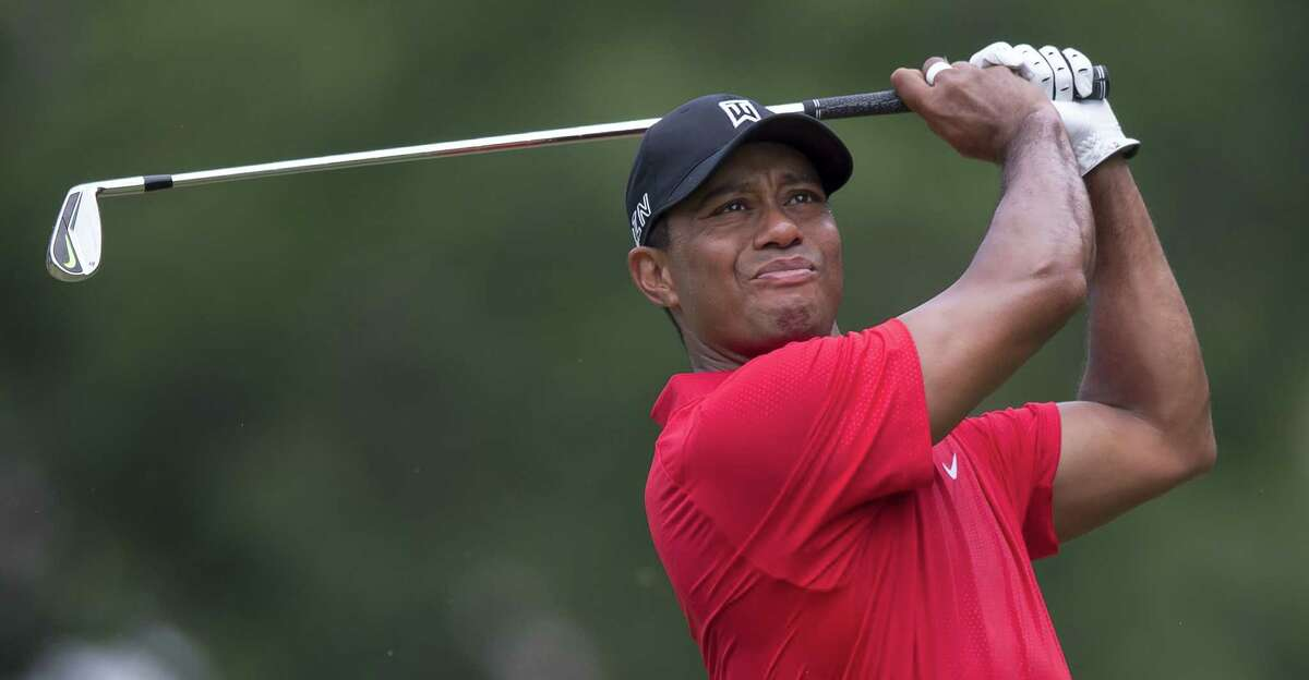 Tiger Woods watches his shot from the third tee during the final round of the Wyndham Championship on Sunday.
