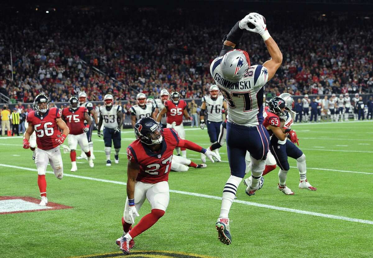 Patriots tight end Rob Gronkowski (87) catches a pass for a touchdown over Texans strong safety Quintin Demps during the first half Sunday in Houston.