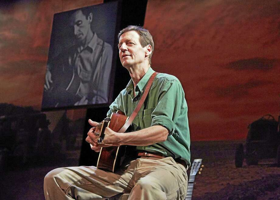 """Photo by Larry Nagler David Lutken as Woody Guthrie in """"Woody Says"""" at TheaterWorks Hartford. Photo: Journal Register Co."""