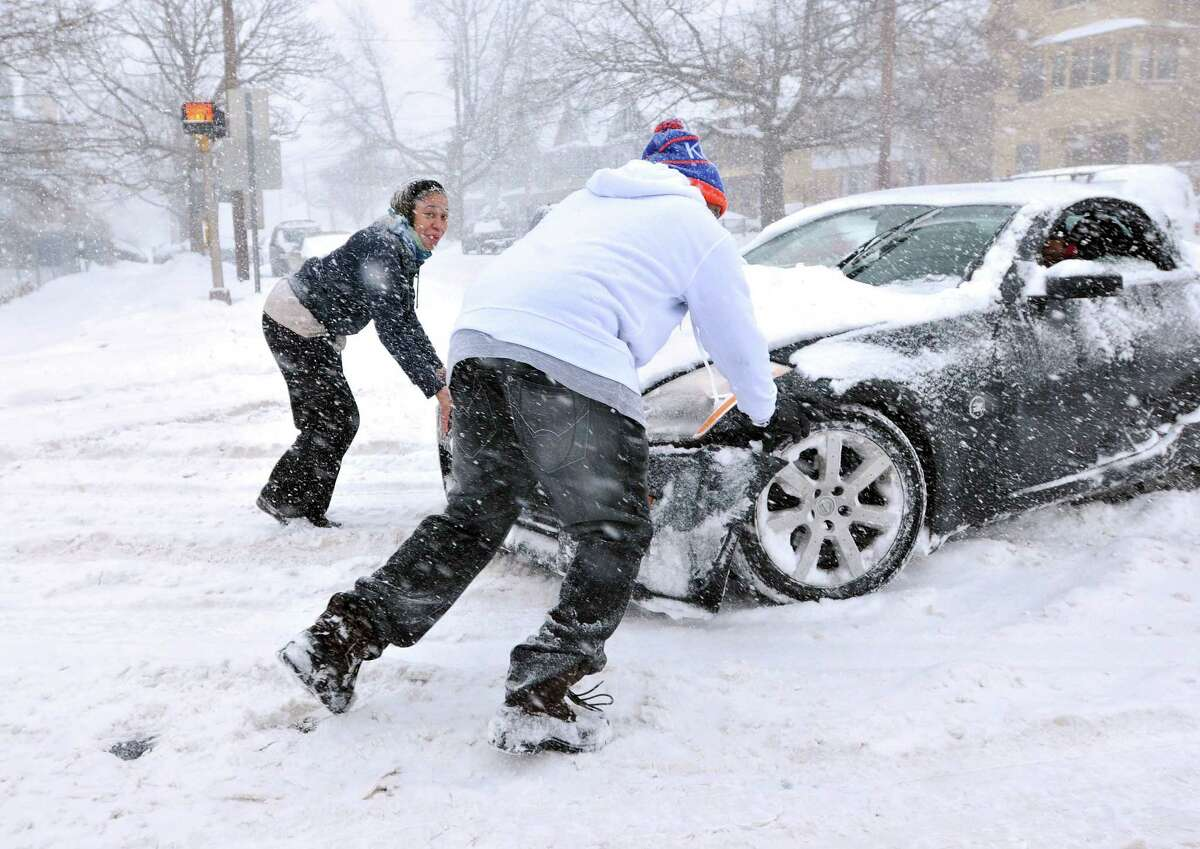 People help a car out of trouble along Ella Grasso Boulevard in New Haven.