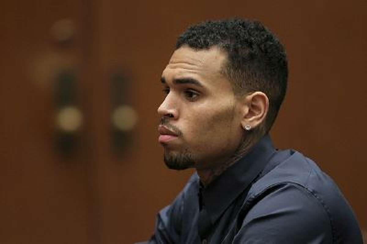 LOS ANGELES, CA - FEBRUARY 03: R&B singer Chris Brown appears in court for a probation progress hearing on February 3, 2014 in Los Angeles, California. Brown has been on probation since pleading guilty to assaulting his then girlfriend, singer Rihanna, after a pre-Grammy Awards party in 2009. He has been in anger management treatment program and performing community service requirements but failure to meet probation requirements could be even further complicated by assault charges he and bodyguard Christopher Hollosy face stemming from an incident outside the W hotel in Washington D.C. last October. (Photo by David McNew/Getty Images)