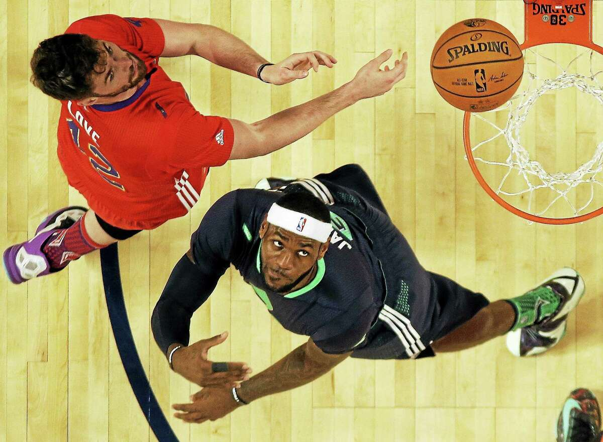 In this Feb. 16 file photo, the West's Kevin Love, left, defends against the East's LeBron James during the NBA All Star Game in New Orleans.