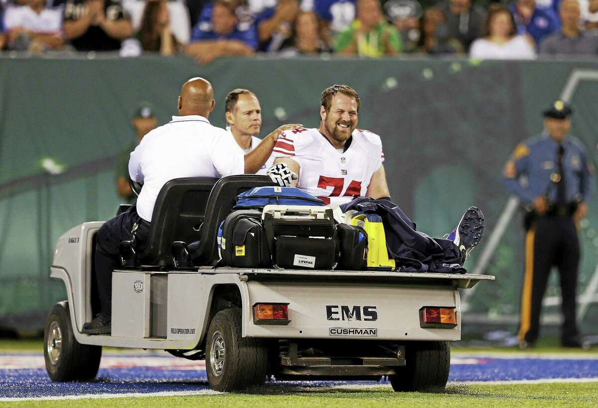New York Giants guard Geoff Schwartz is carted off the field after suffering an injury to his big toe in the second quarter of a preseason game against the New York Jets on Friday in East Rutherford, N.J.