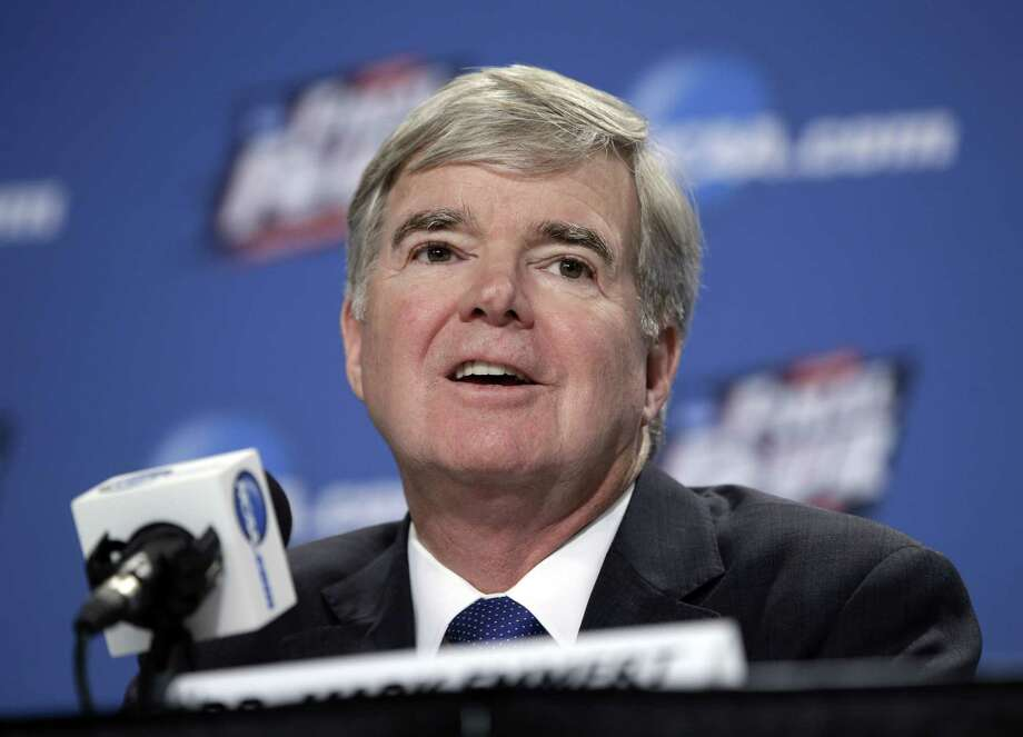 In this file photo from April, NCAA President Mark Emmert answers questions during a news conference at the Final Four college basketball tournament in Indianapolis. Though blocked from forming their own player unions, lawsuits filed by college athletes are still challenging longstanding NCAA rules capping pay. Photo: The Associated Press File Photo  / AP