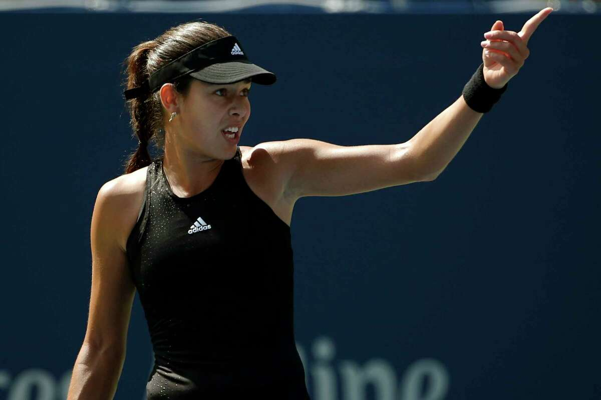 Ana Ivanovic motions to the umpire after a point in the first set against Alison Riske during the opening round of the U.S. Open on Tuesday in New York.