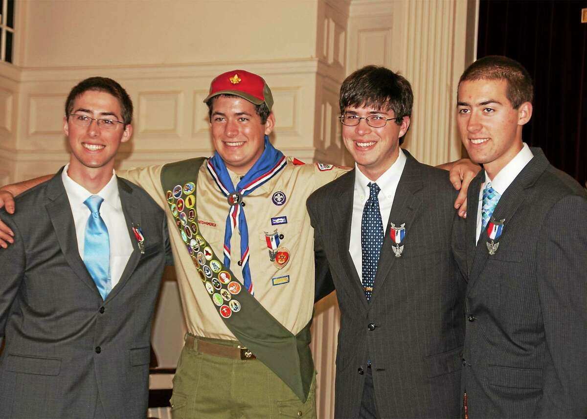 Courtesy Betsy Gates Eli Gates, center, celebrates his Eagle Scout status with brothers Rosse, Caleb and Drew.