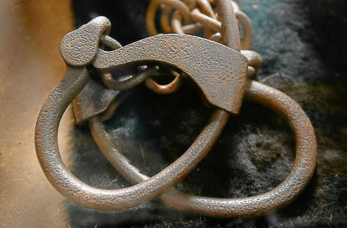 Iron handcuffs, reminders of slavery in the 1800s, are displayed on March 5 at the Bucktown Village Store on Maryland's Eastern Shore, which has been preserved as a museum. Harriet Tubman was injured as a child by a slave owner at the store and suffered lifelong seizures as a result. Illustrates TRAVEL-MARYLAND
