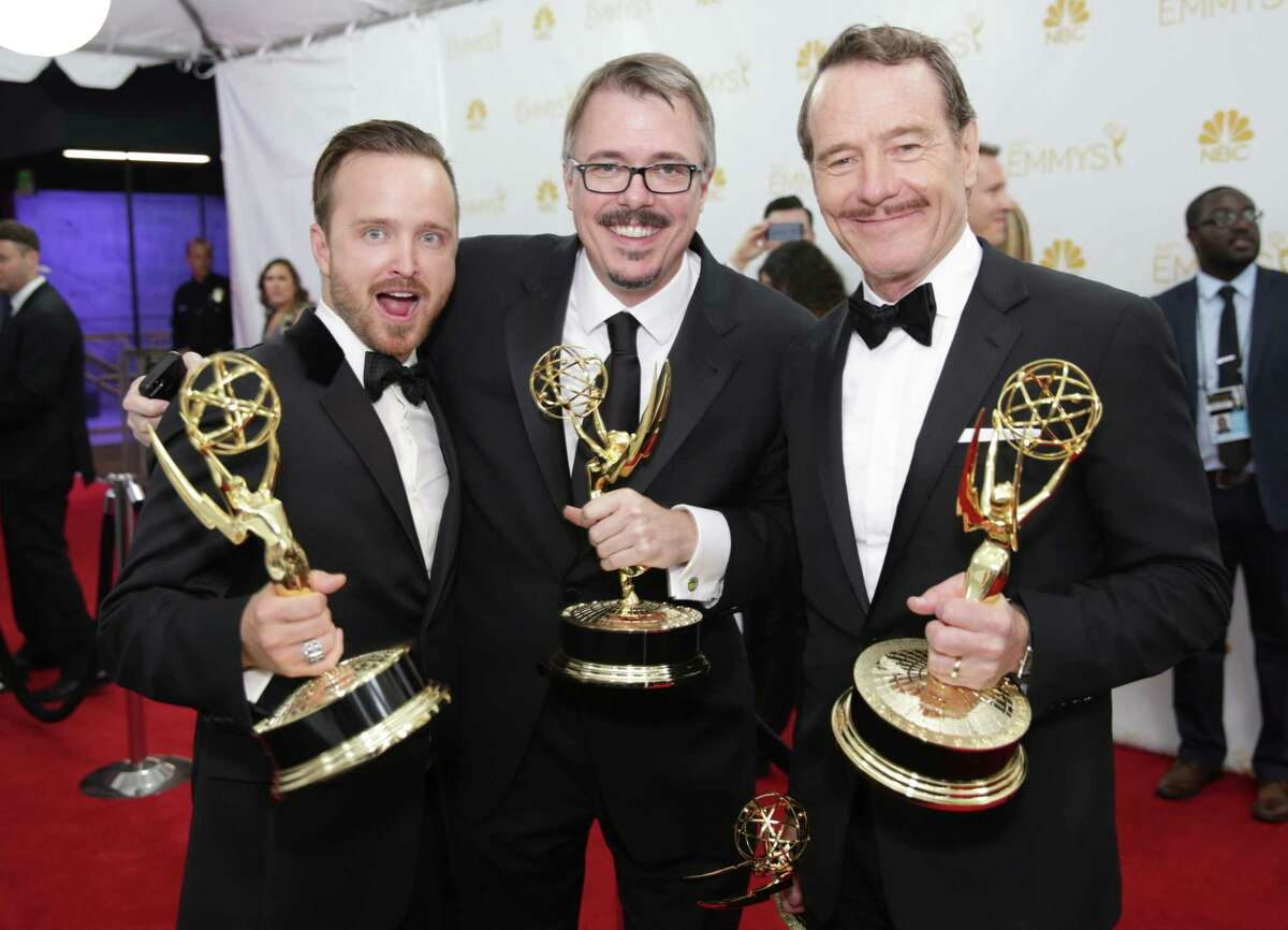 Aaron Paul, left, Vince Gilligan and Bryan Cranston pose at the 66th Primetime Emmy Awards at the Nokia Theatre L.A. Live on Monday, Aug. 25, 2014, in Los Angeles.