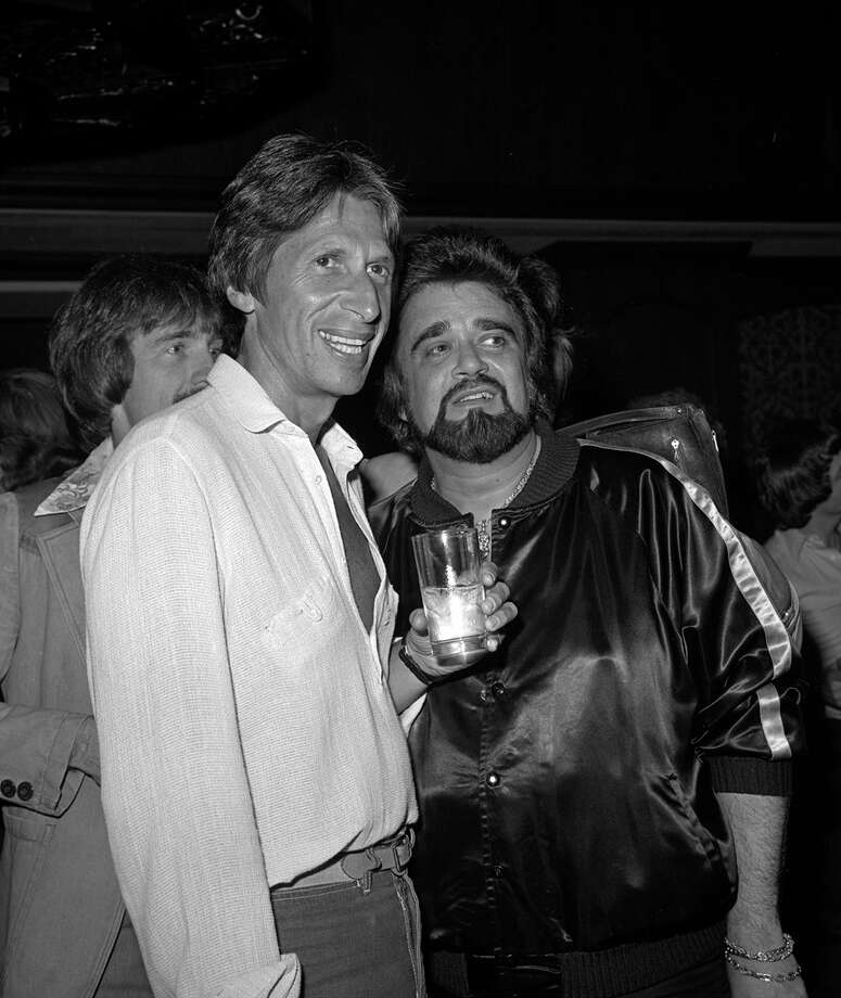 "This 1979 photo released by the  Las Vegas News Bureau shows David Brenner and Wolfman Jack at the Riviera. A spokesman for the family of the comedian  says the ""Tonight Show"" favorite has died. He was 78. Brenner died Saturday March 15, 2014, at his home in New York City, said Jeff Abraham, who was Brenner's publicist. (AP Photo/  Las Vegas News Bureau) Photo: AP /  Las Vegas News Bureau"