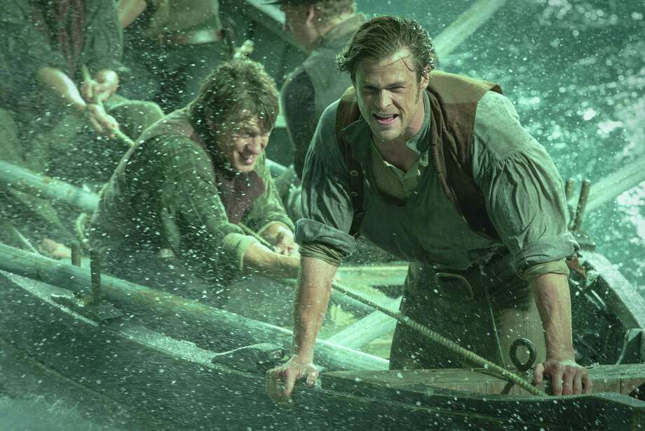 """This photo provided by Warner Bros. Pictures shows, Chris Hemsworth, right, as Owen Chase, and Sam Keeley as Ramsdell, left, in a scene from the film, """"In the Heart of the Sea."""" Photo: Jonathan Prime/Warner Bros. Pictures Via AP  / Warner Bros. Pictures"""