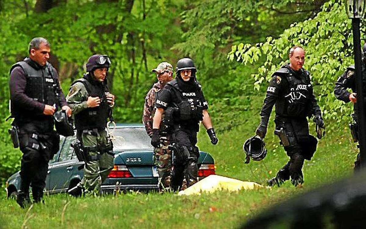 Police at the home on Dogwood Drive, in Easton, Conn. where Gonzalo Guizan was shot and killed by police during a raid on May 18th, 2008. Photo: Christian Abraham.
