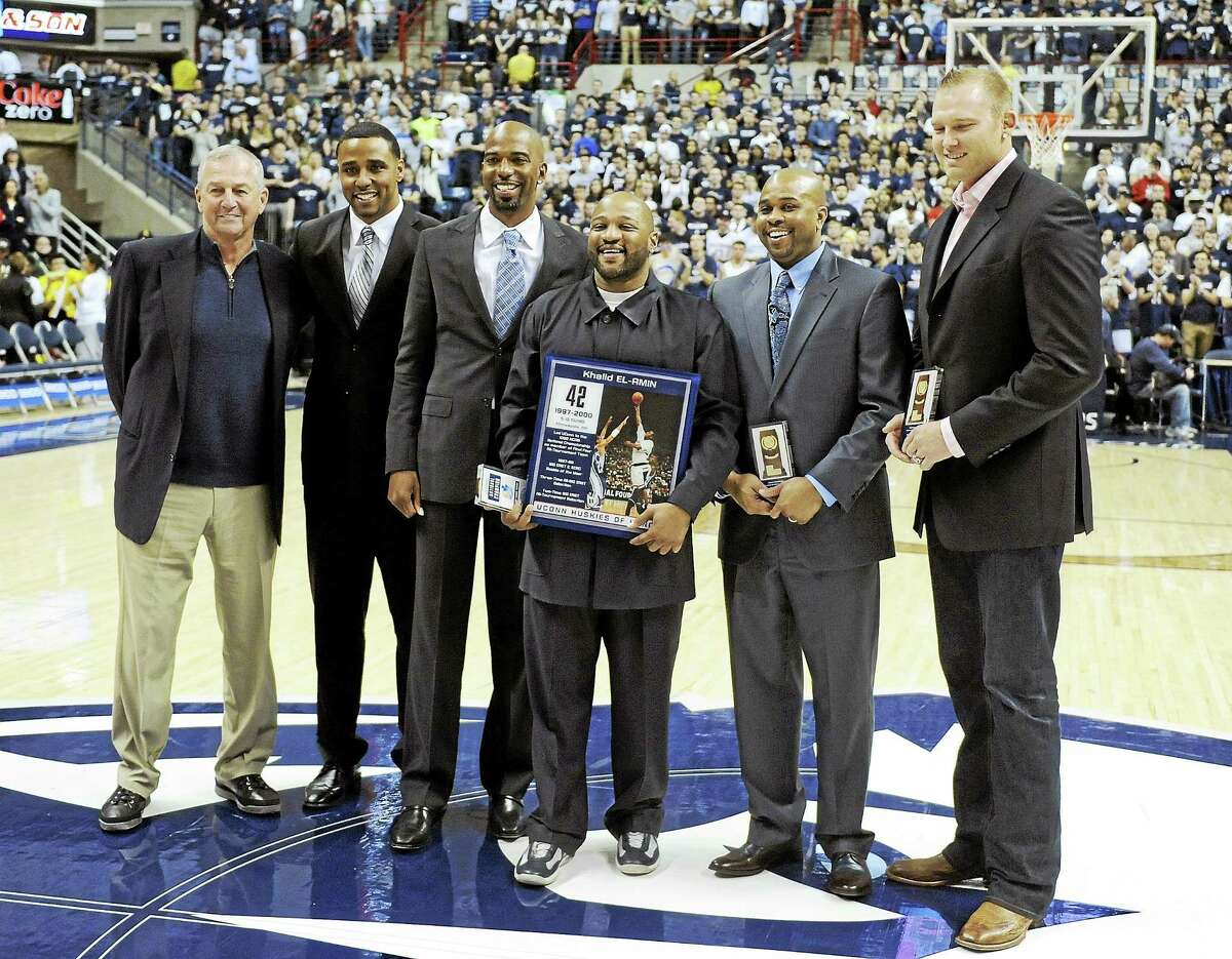 """Members of Connecticut's 1999 national championship team gather before a game between Connecticut and SMU in Storrs, Conn., in February. From left former coach Jim Calhoun, Kevin Freeman, Richard """"Rip"""" Hamilton, Khalid El-Amin, Rickey Moore and Jake Voskuhl."""