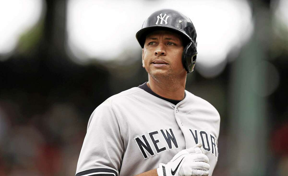 FILE - In this Sept. 14, 2013, file photo, New York Yankees' Alex Rodriguez heads to the dugout during their 5-1 loss to the Boston Red Sox in a baseball game at Fenway Park in Boston. The U.S. government says New York Yankees star Alex Rodriguez paid his cousin almost $1 million to keep secret Rodriguez's use of performance enhancing drugs. In court documents filed last week in Miami, federal prosecutors say Rodriguez paid $900,000 last year to settle a threatened lawsuit by Yuri Sucart, who had worked as Rodriguez's personal assistant. Sucart, in a letter from his lawyer, threatened to expose Rodriquez's PED use if he wasn't paid $5 million.(AP Photo/Winslow Townson, File)
