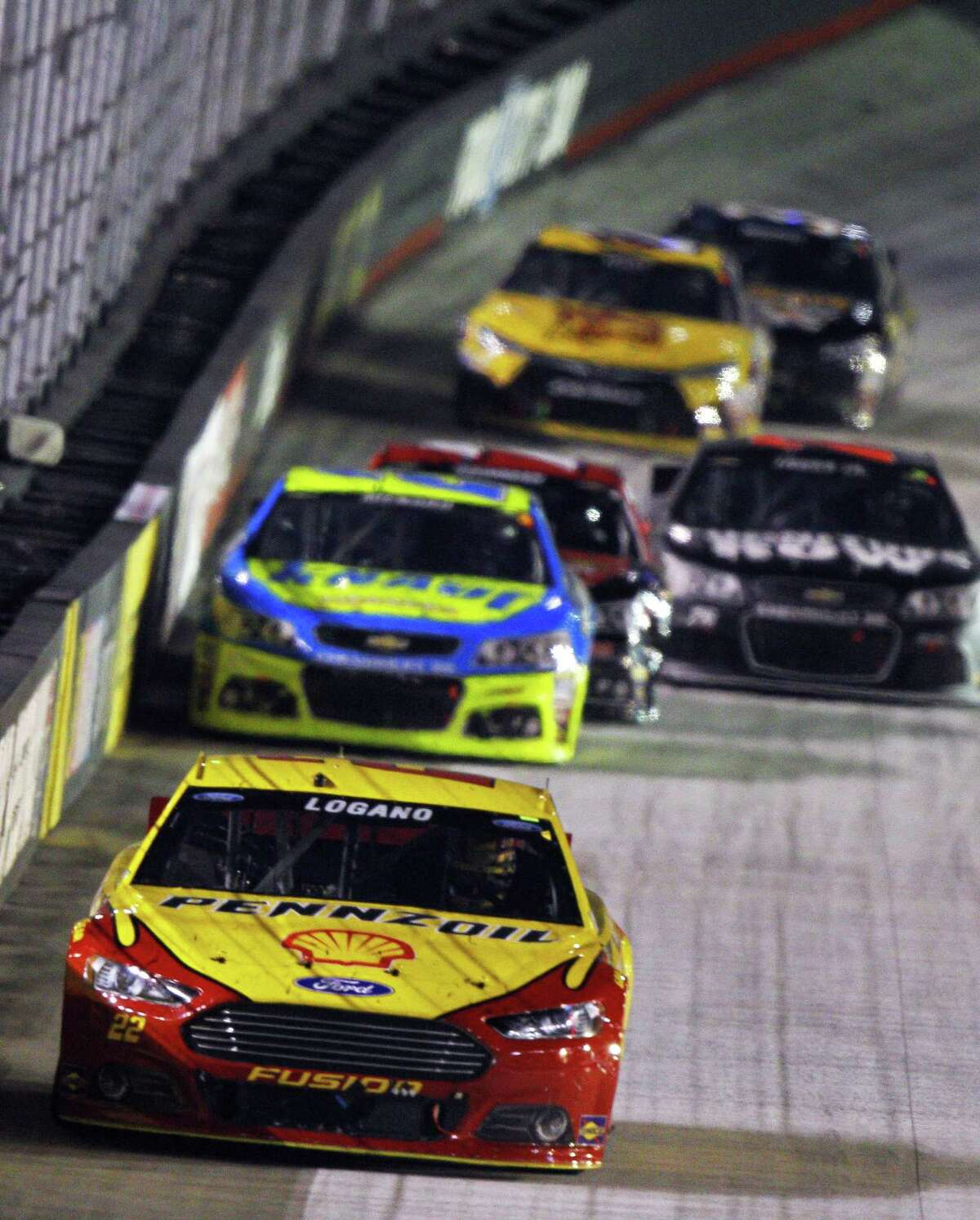 Joey Logano leads a group of cars during the NASCAR Sprint Cup race Saturday in Bristol, Tenn.