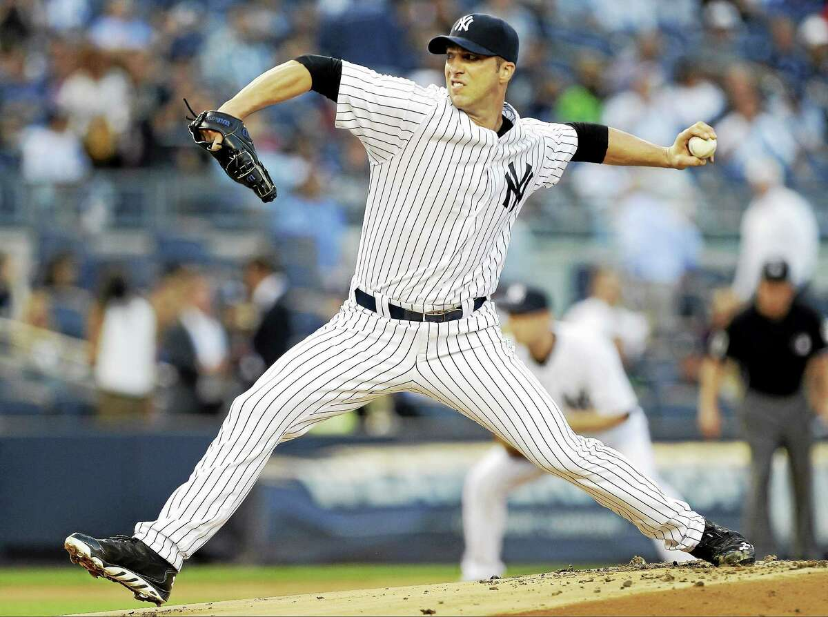 New York Yankees' Chris Capuano delivers a pitch during the first inning of a baseball game against the Houston Astros on Tuesday, Aug. 19, 2014, in New York. (AP Photo/Frank Franklin II)