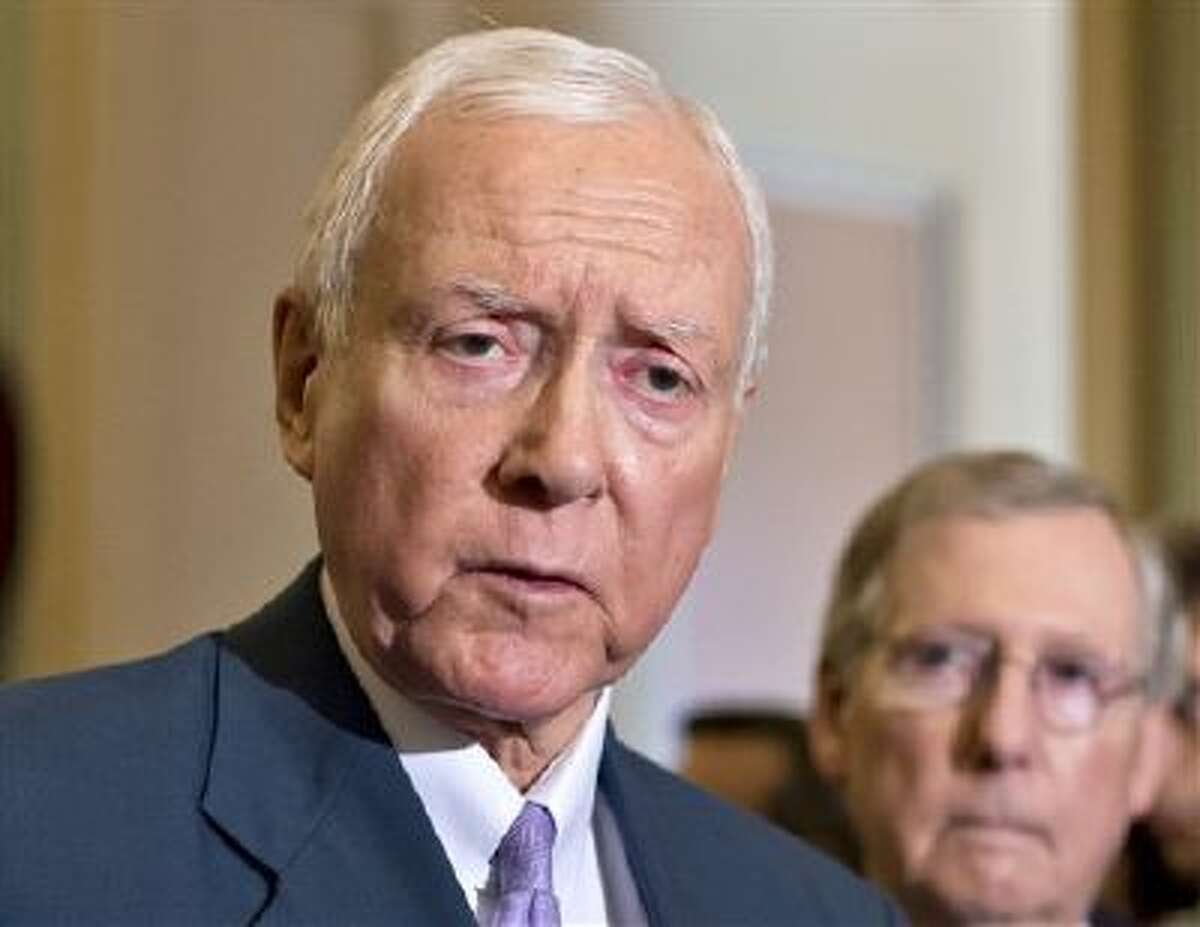 In this July 30, 2013 file photo, Sen. Orrin Hatch, R-Utah, left, accompanied by Senate Minority Leader Mitch McConnell of Ky. speaks with reporters on Capitol Hill in Washington. On Monday, Hatch, Sen. Tom Coburn, R-Okla. and Sen. Richard Burr, R-N.C. proposed repealing the nation's controversial health care law in favor of a Republican replacement. (AP)
