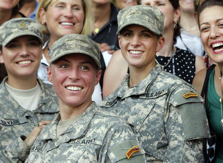 Army First Lt. Shaye Haver, center, and Capt. Kristen Griest, right, pose for photos with other female West Point alumni after an Army Ranger school graduation ceremony Friday at Fort Benning, Ga. Photo: John Bazemore — The Associated Press  / AP