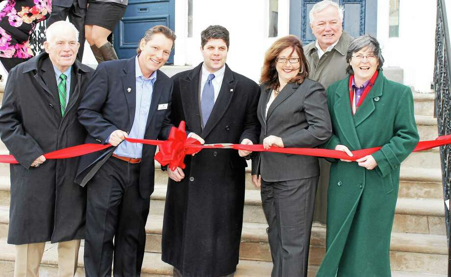 Chamber President Larry McHugh, Chairwoman Darlene Briggs and Mayor Dan Drew help the Re/Max Edge team open their new office on Broad Street in Middletown. From left are McHugh, Office Owner Kurt Potter, Drew, Office Owner Cheryl Kebalo, Bob Leighton and Briggs. Photo: Submitted Photo