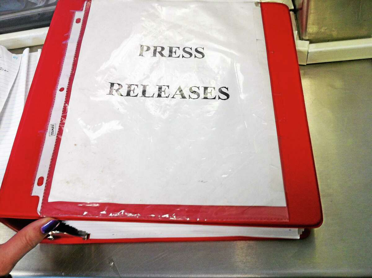 A book of press releases about arrests available in the lobby of the Seymour Police Department for the public.