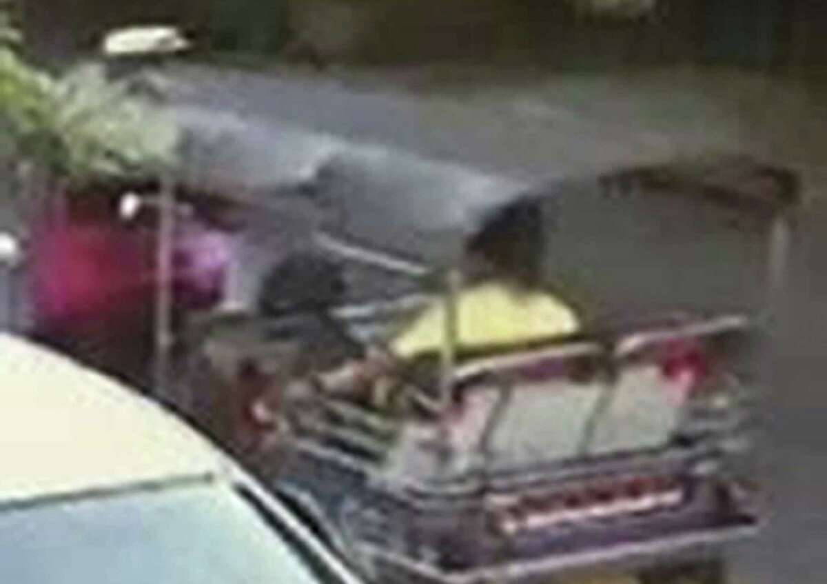 This Aug. 17, 2015, image, released by Royal Thai Police spokesman Lt. Gen. Prawut Thavornsiri shows a man wearing a yellow T-shirt and sitting in a tuk-tuk, a three-wheeled motorized taxi, near the Erawan Shrine in Bangkok, Thailand. Bangkok police on Thursday said they were trying to locate a tuk-tuk driver who may have driven the suspect of Monday's boming to the Erawan Shrine, and announced a 30,000 baht ($850) reward for him to come forward.