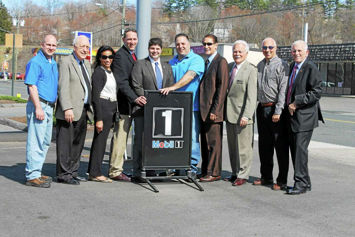 Mobil 1 Express Owner John DeSena marks the opening of his Middletown facility with state Rep. Joe Serra, Realto Jackie Williams, state Sen. Paul Doyle, Mayor Dan Drew, Councilman Tom Serra, the Middlesex County Chamber of Commerce's Paul Dodge, Realtor David Gallitto and Chamber President Larry McHugh.
