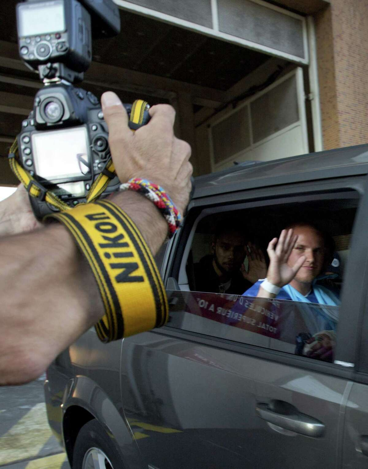 U.S. Marine Spencer Stone waves as he leaves the police station in Arras, northern France, Saturday, Aug. 22, 2015. A gunman prepared to open fire with an automatic weapon on a high-speed train traveling from Amsterdam to Paris Friday, wounding several people before being subdued by passengers, officials said. Spencer Stone is one of the passengers credited with subduing the gunman.