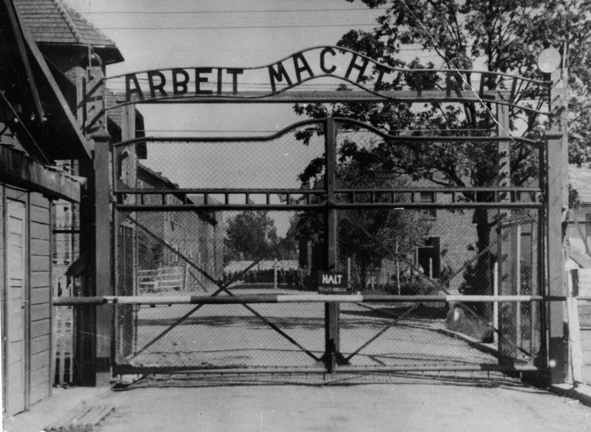 """AP FILE PHOTO- This undated file picture shows the main gate of the Nazi concentration camp Auschwitz I, near Oswiecim , Poland, which was liberated by the Russians in January 1945. Writing at the gate reads: """"Arbeit macht frei"""" (Work makes free - or work liberates)."""