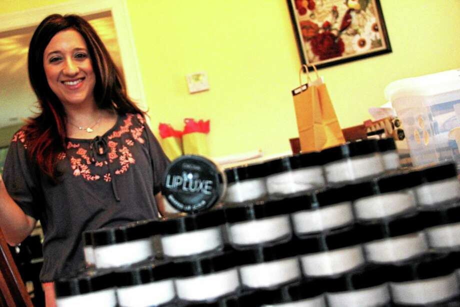 Lip Luxe founder Brenda Mierzejewski creates her all-natural cosmetics at her home in Portland. Photo: Kathleen Schassler — The Middletown Press  / Kathleen Schassler All Rights