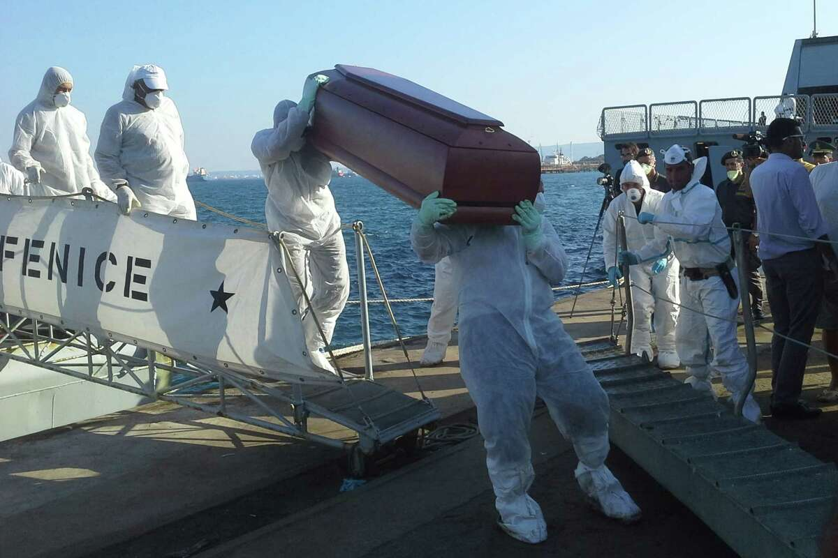 The coffins with bodies of would-be refugees are disembarked in Augusta, Sicily, Tuesday, Aug. 26, 2014. Another 24 bodies were recovered Tuesday from an overturned fishing boat off Italy's southern coast as would-be refugees fleeing increasing instability in Libya saw their deadliest few days this year with more than 300 drowned. The U.N. refugee agency said the worst incident occurred Friday near Garibouli, east of Tripoli. That boat was reportedly carrying at least 270 people when it overturned and sank. Only 19 people survived, according to Melissa Fleming, spokeswoman for the U.N. High Commissioner for Refugees in Geneva. On Tuesday, the Italian navy said two of its patrol boats recovered 24 corpses from a capsized smuggler's boat Sunday night. Their remains, as well as 364 survivors, were headed toward Augusta. (AP Photo/str)