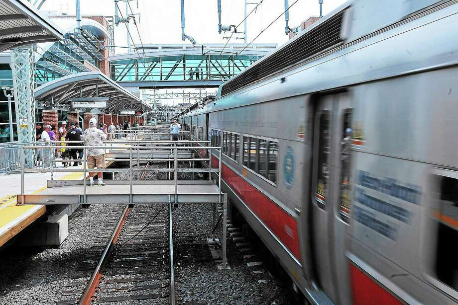A Metro North Train arrives during the grand opening of the new West Haven train station. Photo: Journal Register Co.