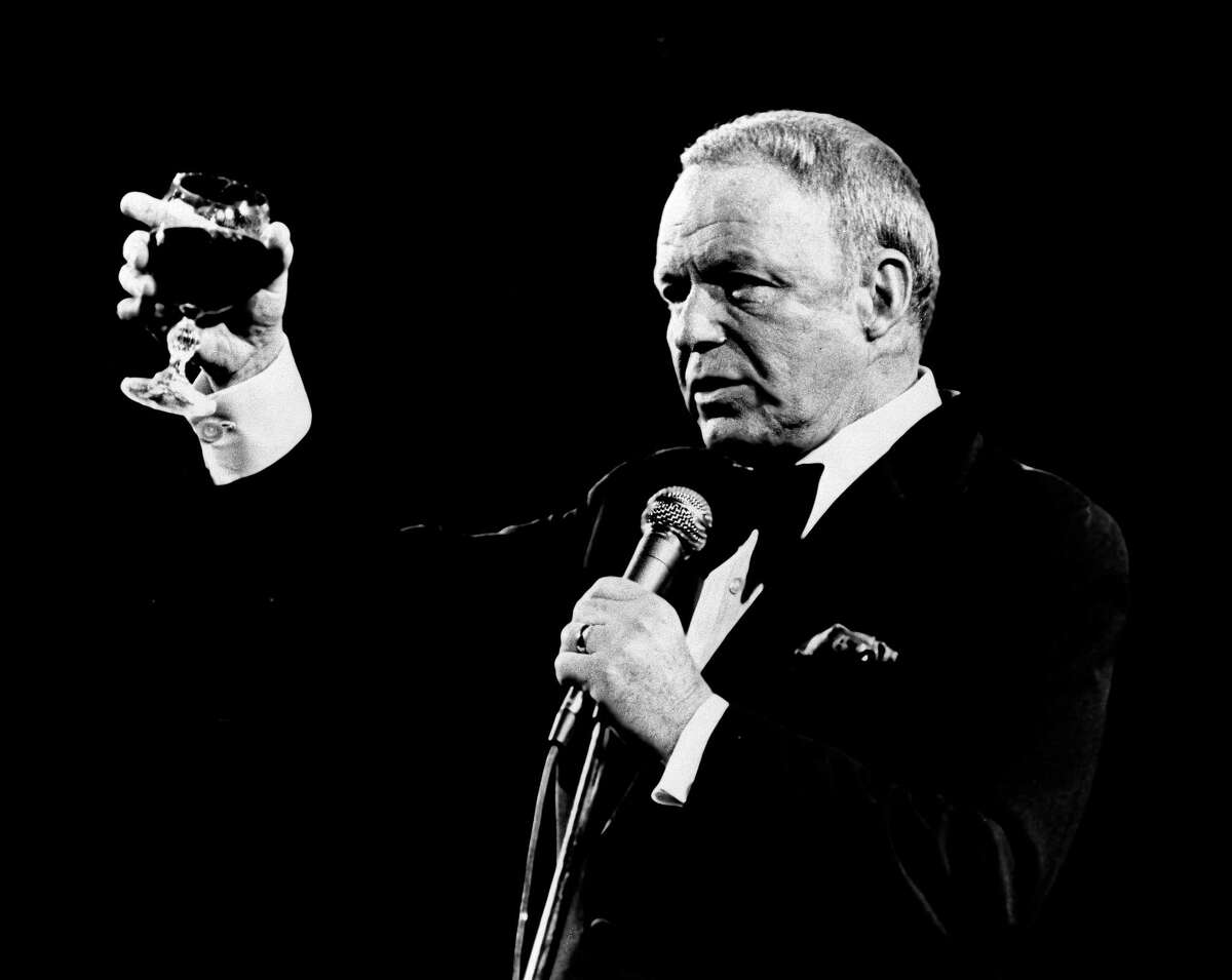 In this Oct. 13, 1976 file photo singer Frank Sinatra performs at the Providence Civic Center in Rhode Island to a capacity crowd. Sinatra, who died in 1998, at 82, would have celebrated his 100th birthday on Dec. 12, 2015. (AP Photo)