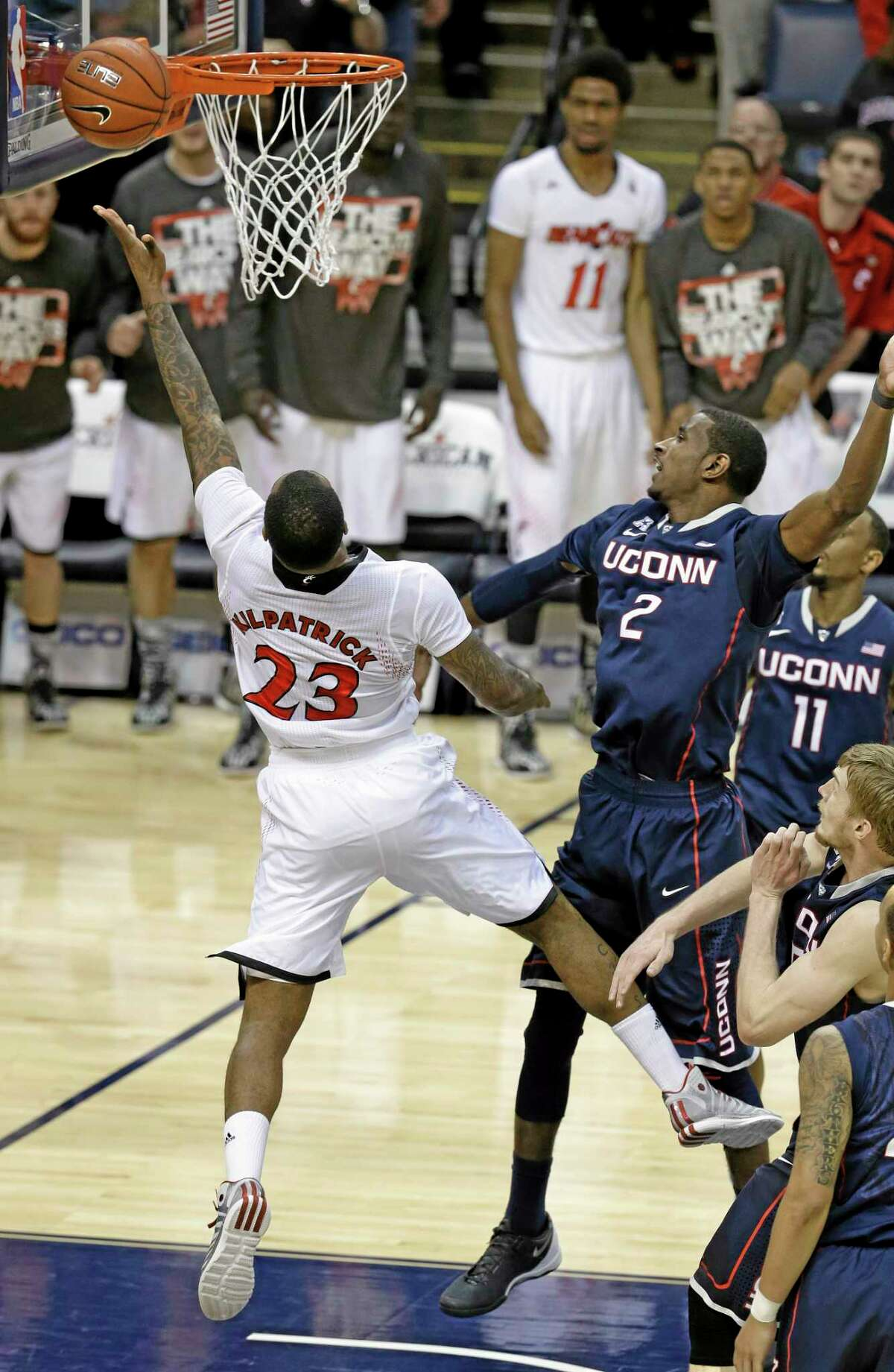 Cincinnati guard Sean Kilpatrick misses a layup as UConn forward DeAndre Daniels (2) defends on the final shot of the Huskies' 58-56 win in the semifinals of the American Athletic Conference tournament on Friday in Memphis, Tenn.
